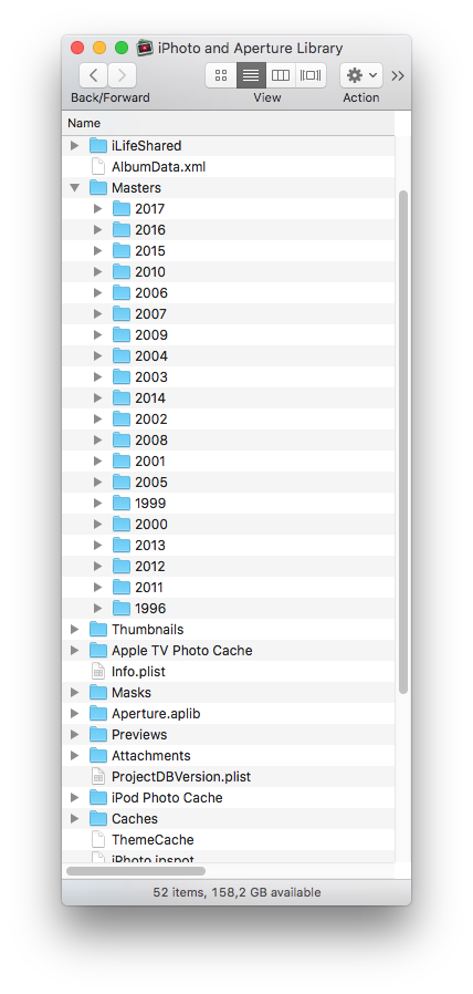 Inside the iPhoto and Aperture Library folder. Icons and databases.